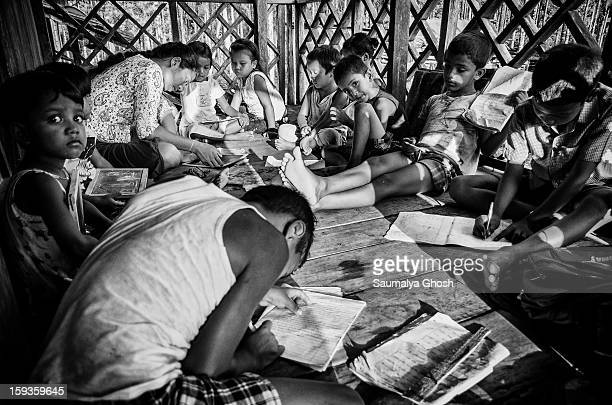 Kids are studying in a village pathsala in the Dooars region of West Bengal.