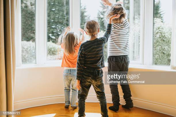 kids at a window - wave stock pictures, royalty-free photos & images