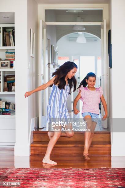 Kids at home running in corridor.