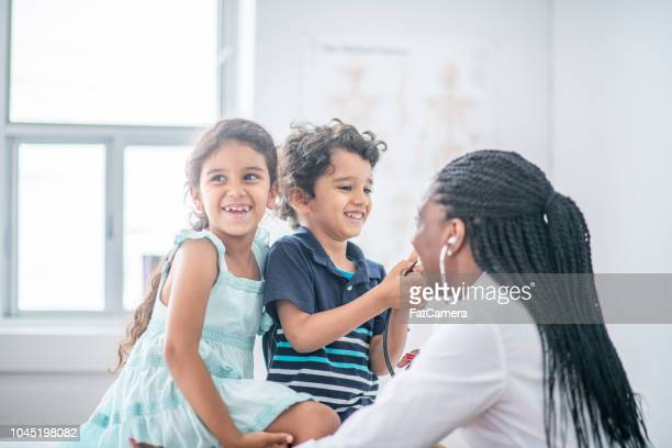 kids at the doctor's - pediatrician stock pictures, royalty-free photos & images