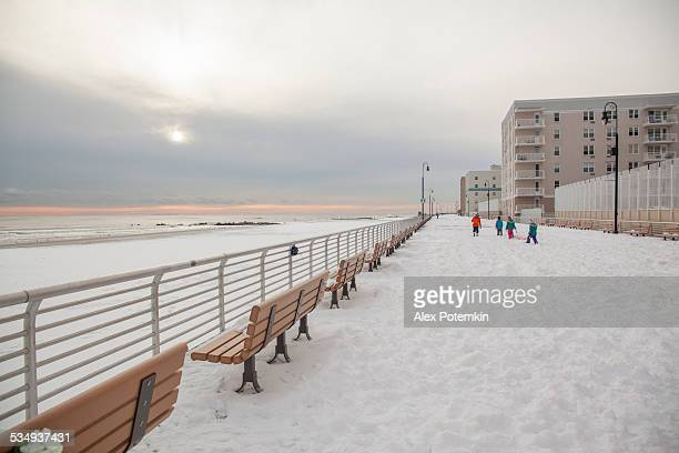 Kids at the Long Beach's boardwalk in winter