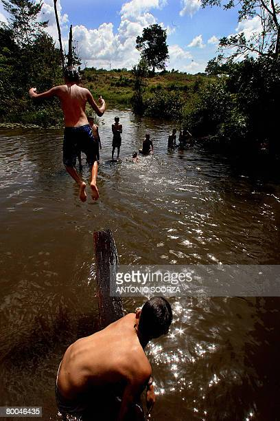Kids bathe in the Moju river in Tailandia Para in northern Brazil on February 27 2008 The Brazilian government launched a largescale...