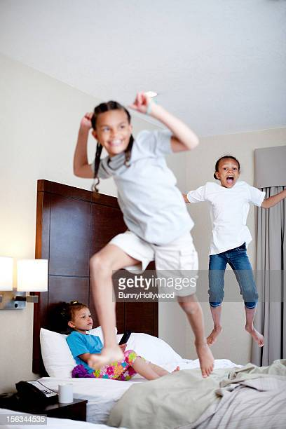 kids bed jumping in hotel room