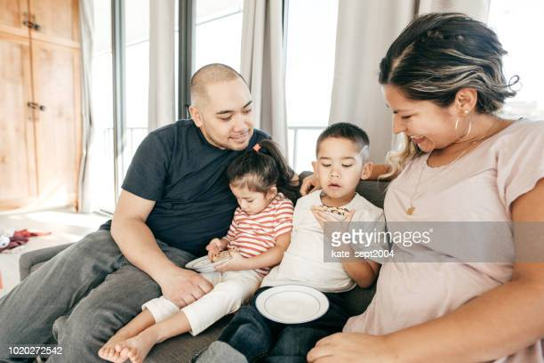 kids' behavior - filipino family eating stock pictures, royalty-free photos & images