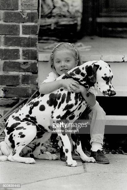 Kid's best friend Caleigh Farrell 5 and her pet Dalmatian Henry get lots of exercise The pet needs lots of attention Caleigh's mom says