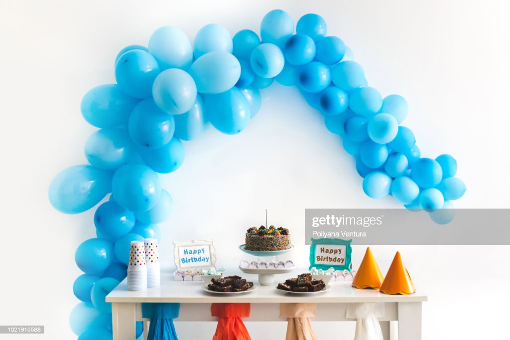Kids birthday party decoration and cake : Stock Photo