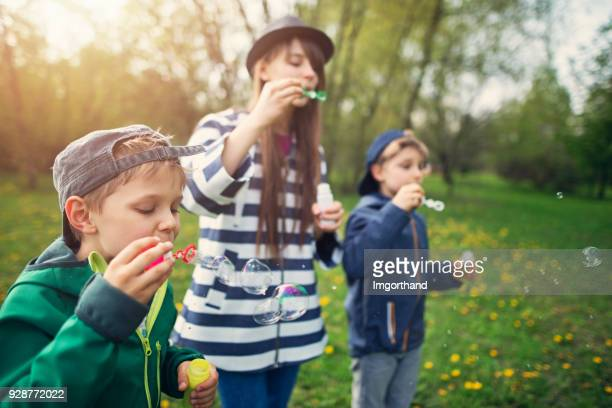 Kids blowing bubbles on Spring day