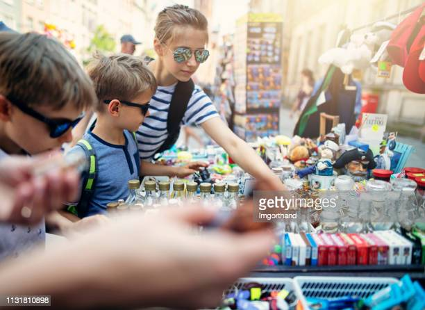 kids browsing souvenirs in city of gdansk - souvenir stock pictures, royalty-free photos & images