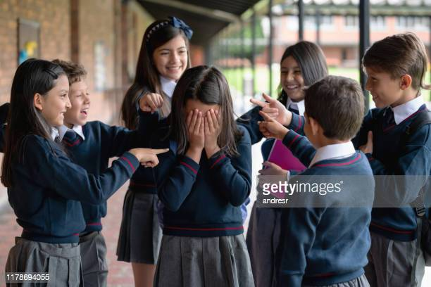 kids bullying a girl at the school - bullying stock pictures, royalty-free photos & images