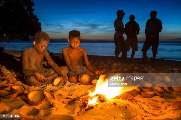 Kids by a campfire
