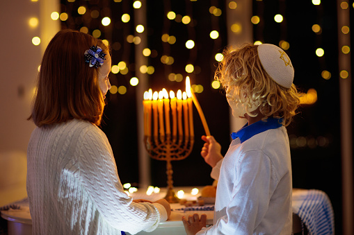 Kids celebrating Hanukkah. Festival of lights. 1186950956