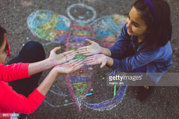 kids chalk drawing on asphalt - chalk art equipment stock pictures, royalty-free photos & images