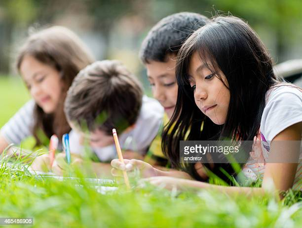 Kids coloring at the park
