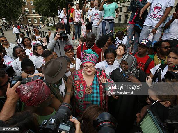 Kids Company founder Camila Batmanghelidjh is surrounded by supporters and camera crews as she attempts to join other staff members in a rally...