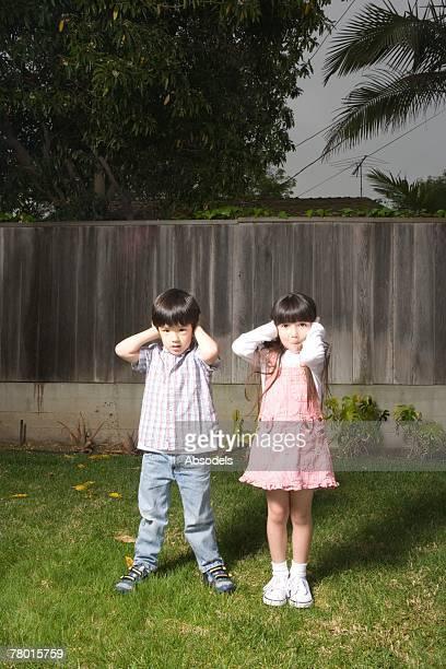 Kids covering ears