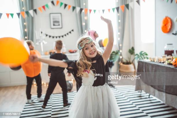 kids dancing on halloween party - mask dance stock pictures, royalty-free photos & images