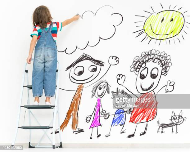 kid's drawing colourful family on wall - animation stock pictures, royalty-free photos & images