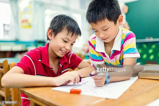 Kids drawing in class