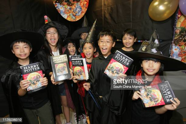 Kids dress up to play as Harry Potter and Hermione Granger to show up their Harry Potter 7 on the launch party at Kelly and Walsh Ltd. In Exchange...