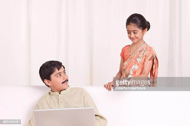 kids dressed as husband and wife shopping online - mangala sutra fotografías e imágenes de stock