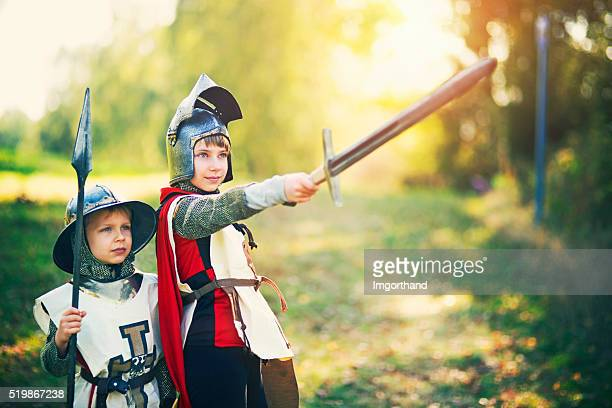 Kids dressed up as knights playing outdoors