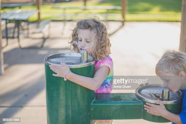 Kids Drinking out of Drinking Fountain