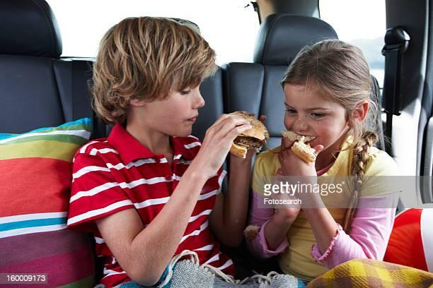 Kids eating a hamburger