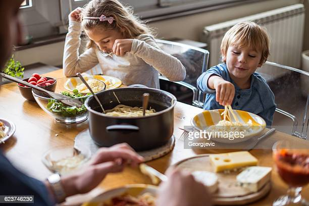 Kids eating pasta for lunch