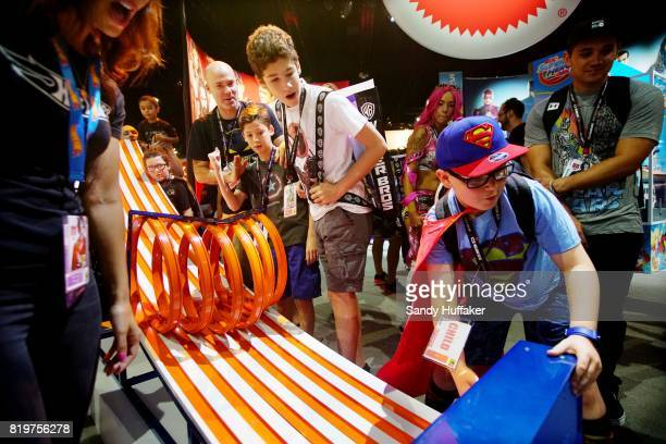Kids engage in a box car race at the Mattell booth during Comic Con International on July 20 2017 in San Diego California Comic Con International is...