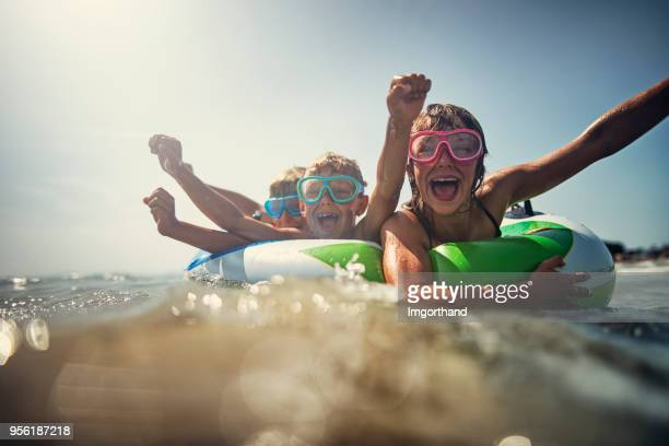 kids enjoying beach and sea vacations - beach fun stock pictures, royalty-free photos & images