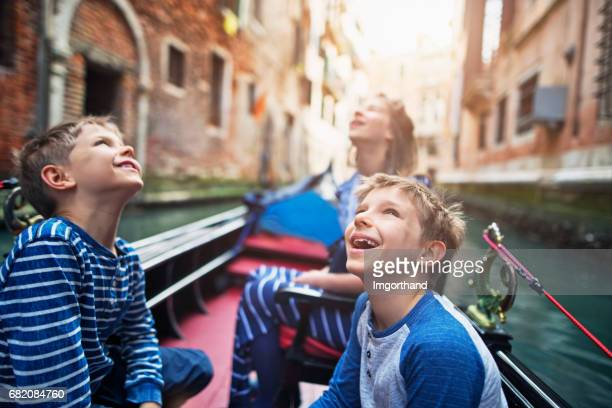 Kids enjoying gondola ride in Venice, Italy