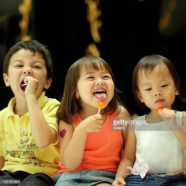 Kids enjoying lollipop