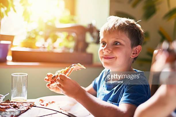 Kids enjoying pizza lunch