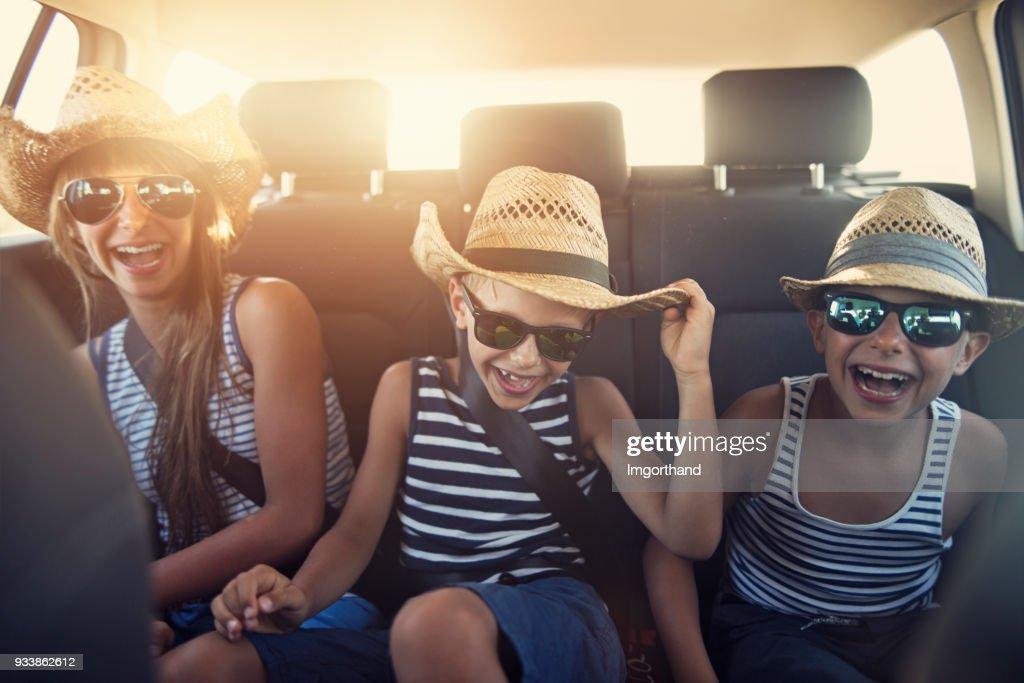 Kids enjoying road trip on sunny day : Stock Photo