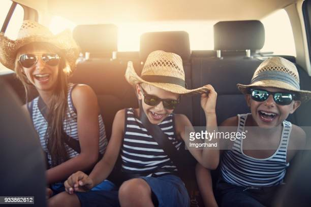 kids enjoying road trip on sunny day - family inside car stock photos and pictures