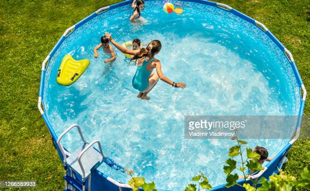 kids enjoying splashing in swimming pool - physical structure stock pictures, royalty-free photos & images