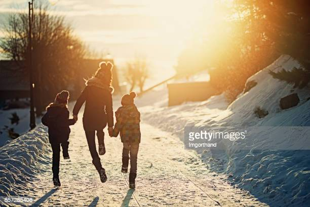 kids enjoying winter - winter weather stock photos and pictures