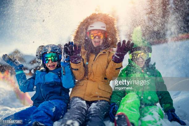 kids enjoying winter vacations - ski holiday stock pictures, royalty-free photos & images