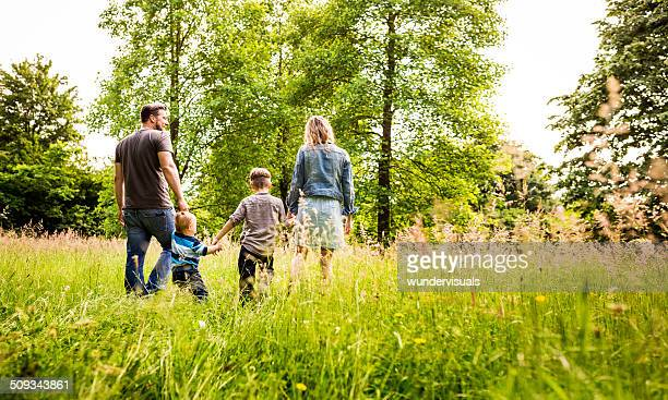 Kids exploring Park with parents