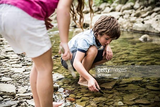 Kids exploring stream