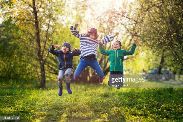 Kids filled with Spring energy jumping