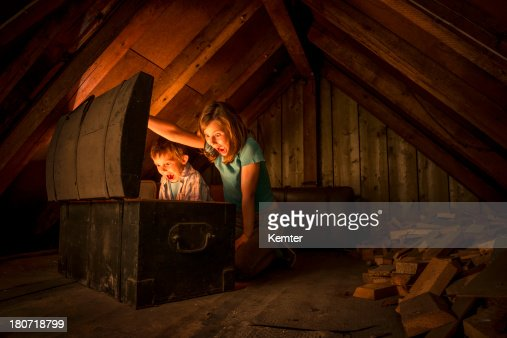 Kids Finding A Treasure Chest At The Attic Stock Photo