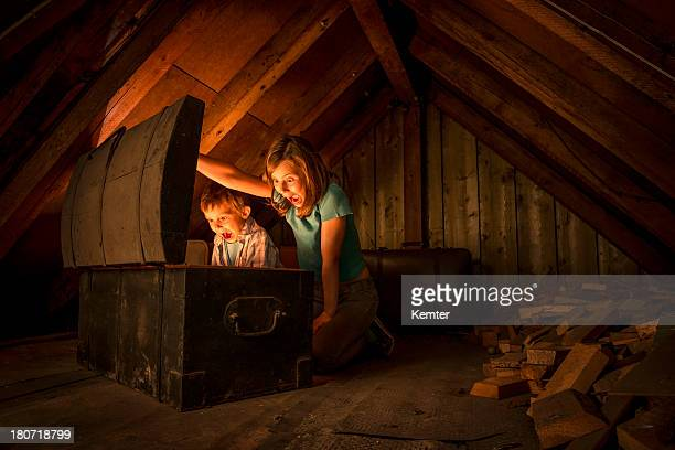 kids finding a treasure chest at the attic - girls open mouth stock photos and pictures