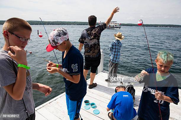 Kids fish at The One Step Summer Camp on Friday July 22 2016 at Geneva Lake in Williams Bay Wis The One Step Summer Camp focuses on creating an...
