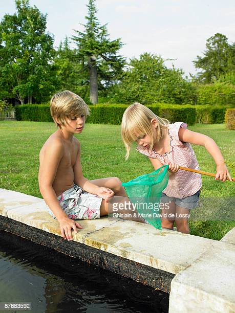Kids fishing in a pond