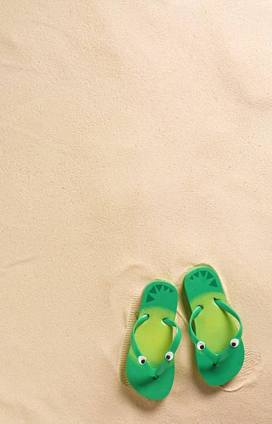 23104c226de5 Kids flip-flops on beach