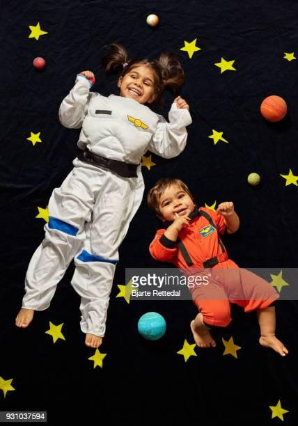 Kids floating in space