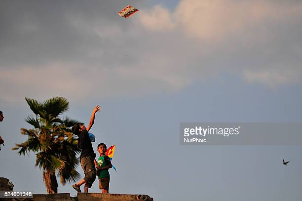Kids flying kite in the open space of Bhaktapur Durbar Square Bhaktapur Nepal on Saturday 17 oct 2015 People used to fly kite to give message to the...