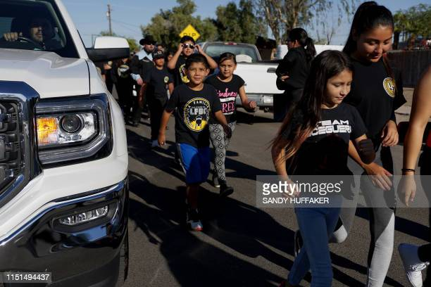 Kids from La Familia Boxing Gym prepare to march in a parade in honor of Heavyweight boxing champion Andy Ruiz Jr on June 22 2019 in Imperial...