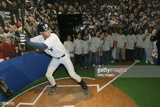 Kids from the Gloria Wise Boys And Girls Club attend the launch of a new interactive experience featuring a figure of baseball player Derek Jeter at...